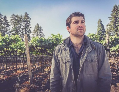 Outdoor photo of Joe Wagner in front of Taylor Lane vineyard